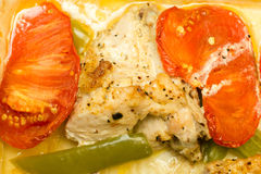 Baked chicken with peppers and tomatoes. Close up Stock Image