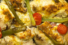 Baked chicken with peppers and tomatoes. Close up Royalty Free Stock Images