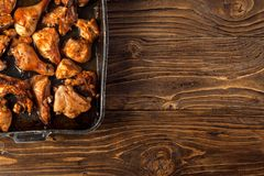 Baked chicken pieces on baking sheet stock photo