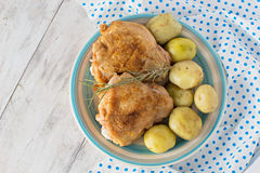 Baked chicken on the plate Stock Images