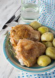 Baked chicken on the plate Royalty Free Stock Images