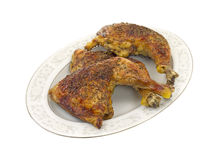Baked chicken on platter Stock Images