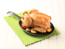 Baked chicken and potatoes Royalty Free Stock Image