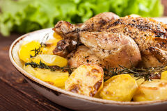 Baked chicken with potatoes Stock Photo