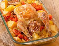 Baked chicken with potatoes Royalty Free Stock Photography