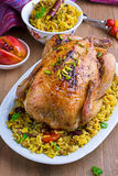 Baked chicken with rice and dried fruits. On the plate Stock Photos
