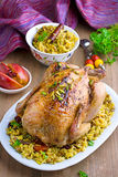 Baked chicken with rice and dried fruits. On the plate Royalty Free Stock Photo