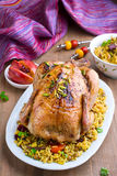 Baked chicken with rice and dried fruits. On the plate Royalty Free Stock Photos