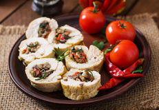 Baked chicken rolls with mushrooms and paprika. On brown plate royalty free stock photography