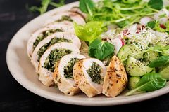 Baked chicken rolls with spinach and cheese on plate. Healthy lunch. stock images