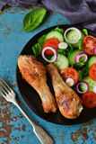 Baked chicken with a side dish of vegetable salad Royalty Free Stock Photo