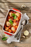 Baked chicken sticks in tomato sauce with onion, pepper and garl Royalty Free Stock Photos