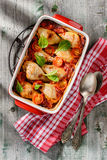 Baked chicken sticks with tomatoes and tomato sauce Stock Photos