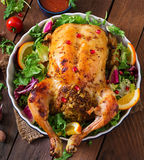 Baked chicken stuffed with rice for Christmas. Royalty Free Stock Photos