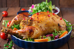 Baked chicken stuffed with rice for Christmas. Stock Photos