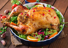 Baked chicken stuffed with rice for Christmas. Royalty Free Stock Photo