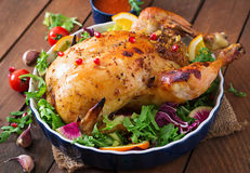 Baked chicken stuffed with rice for Christmas. Stock Photography