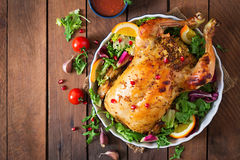 Baked chicken stuffed with rice for Christmas dinner on a festive table. Stock Image