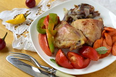 Baked chicken thigh with roasted vegetables Stock Photography