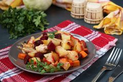 Baked chicken with vegetables: beets, carrots, cabbage and potatoes stock image