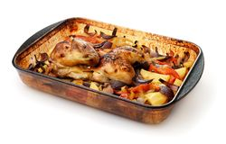 Baked chicken with vegetables in glass baking tray royalty free stock photos