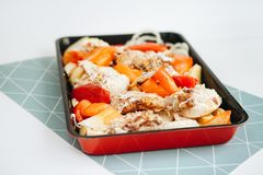 Baked chicken with vegetables and mayonnaise stock photo