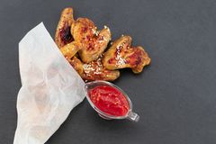 Baked chicken wings on dark background with copy space. Top view royalty free stock photos