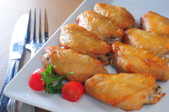 Baked chicken wings. On dish Royalty Free Stock Images