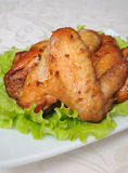 Baked chicken wings with garlic Royalty Free Stock Photo