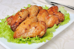 Baked chicken wings with garlic Royalty Free Stock Photos