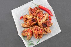 Baked chicken wings with sauce. Food background. Top view royalty free stock photo