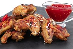 Baked chicken wings with sesame and sauce. Food background stock images