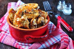 Baked chicken wings in soy sauce with sesame seeds Stock Photos