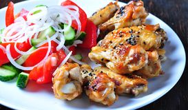 Baked chicken wings in soy sauce with sesame seeds Royalty Free Stock Photography