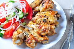 Baked chicken wings in soy sauce with sesame seeds Royalty Free Stock Image