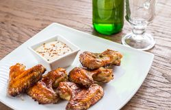 Baked chicken wings with spicy sauce Stock Images