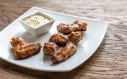 Baked chicken wings with spicy sauce Stock Image