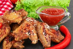 Free Baked Chicken Wings With Sesame Seeds And Sweet Chili Sauce On Dark Background Royalty Free Stock Image - 139481246