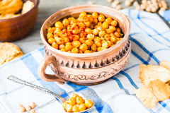 Baked chickpeas with spices on rustic background, smoked paprika Royalty Free Stock Images