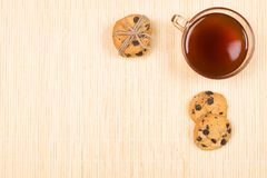 Baked chocolate chip cookies and cup of tea royalty free stock image