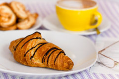 Baked,chocolate croissant ,on white plate Stock Images