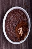 Baked chocolate risotto. In white plate Royalty Free Stock Images