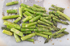 Baked chopped asparagus on the parchment paper Royalty Free Stock Photo