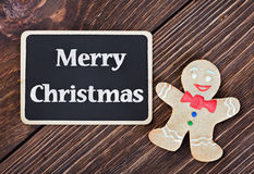 Baked Christmas cookies man and a blackboard Stock Images