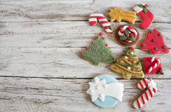 Baked Christmas cookies. Baked Christmas cookies on a wooden table royalty free stock images