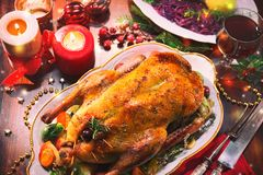 Baked Christmas duck. With thyme and apples stock photos