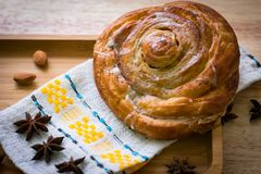 Baked cinnamon roll on cloth napking royalty free stock images