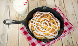 Baked cinnamon rolls in skillet Royalty Free Stock Images