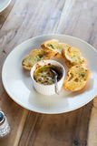 Baked Clams with garlic bread on white dish Stock Image