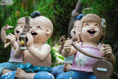 Baked clay dolls in the garden Royalty Free Stock Image